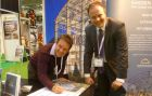 Charlie Groves signs for a new Smiemans building